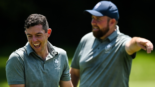 Rory McIlroy (L) and Shane Lowry are well placed in tied 7th after 36 holes