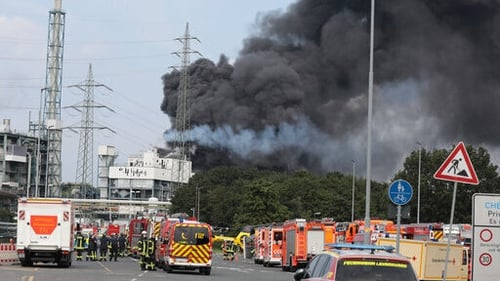 Smoke rises from the explosion site at Chempark Leverkusen in Germany