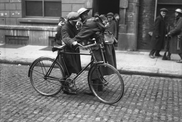 British soldier searching a civilian in Dublin in 1921 during the War of Independence. Photo: RTÉ Archives 0505/021
