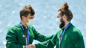 Fintan McCarthy, left, and Paul O'Donovan of Ireland celebrate with their gold medals after winning the Men's Lightweight Double Sculls final at the Sea Forest Waterway during the 2020 Tokyo Summer Olympic Games in Tokyo, Japan. Photo by Seb Daly/Sportsfi