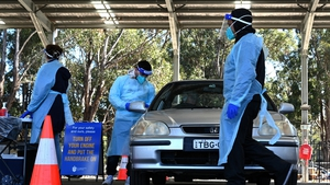 Health workers taking swab samples from residents at a Covid-19 drive-through testing clinic in Sydney