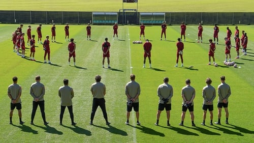 The Liverpool squad observes a 97-second silence for Andrew Devine