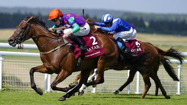 Kieran Shoemark (in the orange cap) steers Lady Bowthorpe to the Qatar Nassau Stakes at Goodwood