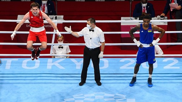 Aidan Walsh celebrates winning bronze at least in welterweight boxing