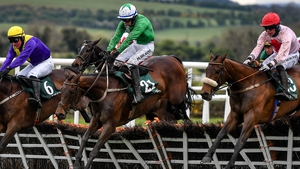 Conor McNamara and Jazzaway (centre) jump the last
