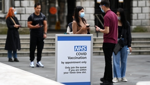 People queue up at a Covid-19 vaccination centre in London