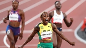Elaine Thompson-Herah celebrates victory in the women's 100m final
