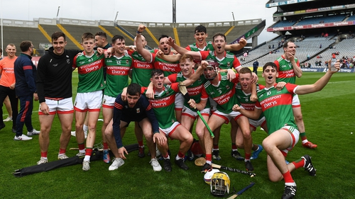 The Mayo team celebrate after their 16-point win over Tyrone