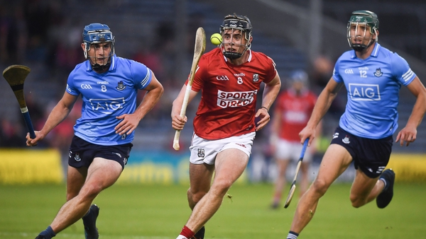 Darragh Fitzgibbon of Cork in action against Rian McBride, left, and Chris Crummey