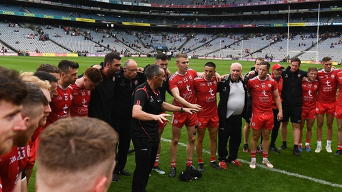 Tyrone joint-manager Brian Dooher talks to the Tyrone squad after their Ulster final win over Monaghan