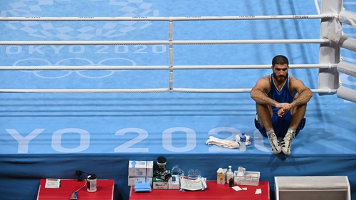Mourad Aliev sits on the edge of the ring
