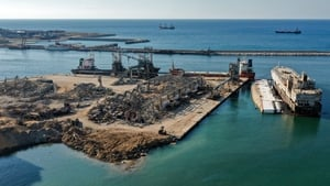 An aerial view of the flattened warehouse at the port of Beirut next to the crater left by the explosion last year