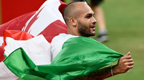 Italy's Lamont Marcell Jacobs celebrates his remarkable victory