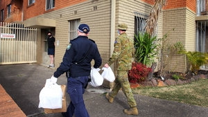 Australian Defence Force personnel and NSW police deliver food packages to those people in lockdown in Sydney