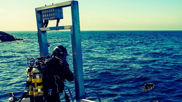 A diver prepares to enter the water at the La Girona wreck site
