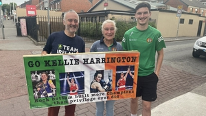 Kellie Harrington's father Christy, mother Yvonne and brother Christopher celebrate outside their Dublin home