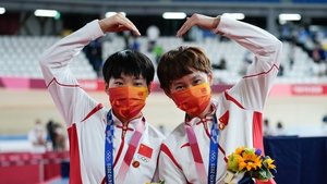 Cyclists Bao Shanju and Zhong Tianshi wore the badges during their gold medal ceremony