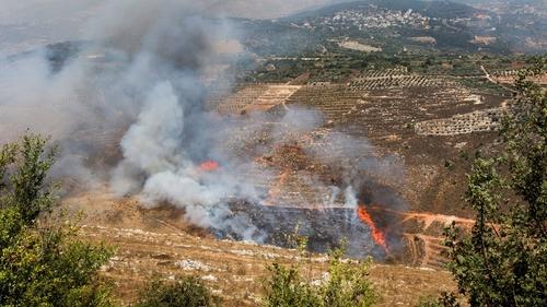 Smoke billows in the towns of Ibl Al-Saqi and Kfar Hamam in southern Lebanon