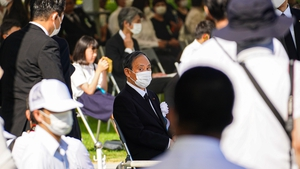 Prime Minister Suga attends a commemoration at Peace Memorial Park