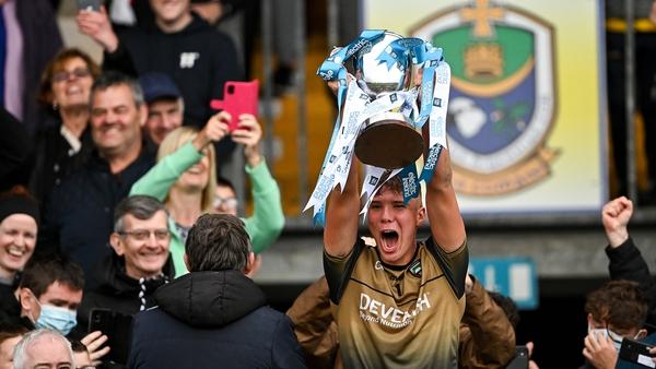 Sligo's Kyle Davey proudly lifts the cup