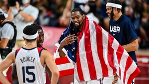 Kevin Durant celebrates with other member of the USA team at Saitama Super Arena