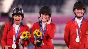 (L-R) Laura Kraut, Jessica Springsteen and McLain Ward of the US team receive their medals at Equestrian Park in Tokyo on Saturday
