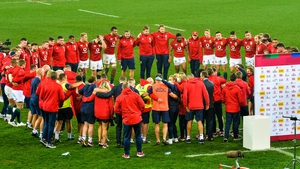 The Lions huddle after the match