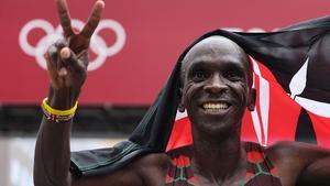 Kenya's Eliud Kipchoge celebrates his gold