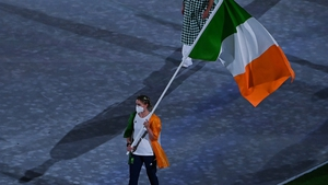 Natalya Coyle carries the Irish flag at the closing ceremony