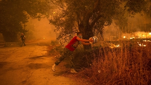 The fires are continuing to destroy homes and land, pic: Getty