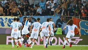 Marseille's players react after ex-West Ham playmaker Dimitri Payet found the net