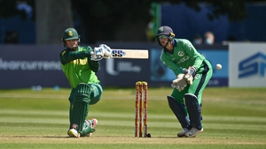 Rassie van der Dussen of South Africa plays a shot, watched by Ireland wicketkeeper Lorcan Tucker during an ODI in July
