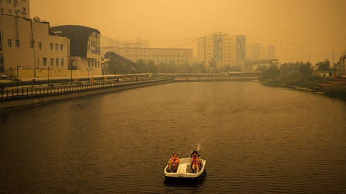 Smoke from nearby forest fires hangs over the city of Yakutsk