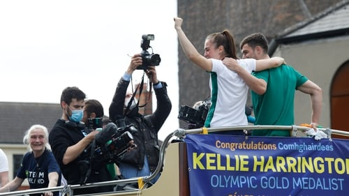 Kellie Harrington and Emmet Brennan wave from the open-top bus as Kellie's mother Yvonne (far left) looks on (Pic: Rolling News)