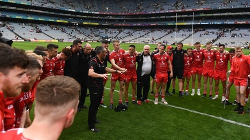 Tyrone joint-manager Brian Dooher speaking to the players after the win over Monaghan