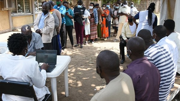 Residents in Nairobi, Kenya, wait in line to register in order to receive their first dose of the AstraZeneca Covid-19 vaccine