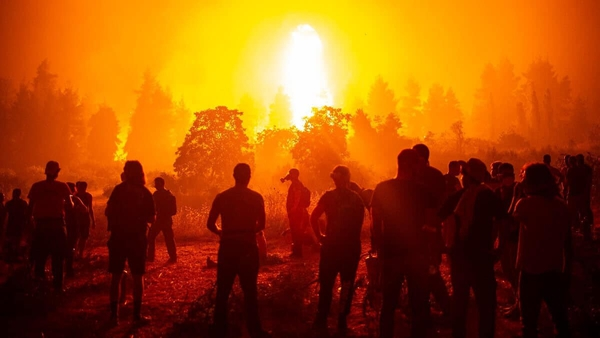 Fact, not fiction: people watching as wildfires rage on the Greek island ofEvia. Photo: Angelos Tzortzinis/Getty Images