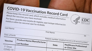 A Covid-19 vaccination record card issued in Los Angeles