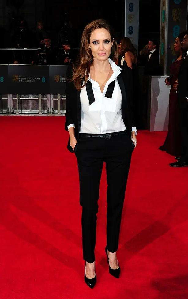 Angelina Jolie wearing a tuxedo to the 2014 Baftas (Ian West/PA)