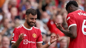 Bruno Fernandes celebrates scoring his hat-trick goal with Paul Pogba