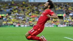 Mo Salah celebrates scoring Liverpool's third goal