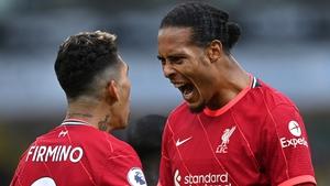 Van Dijk celebrates with Roberto Firmino after the second Liverpool goal at Carrow Road