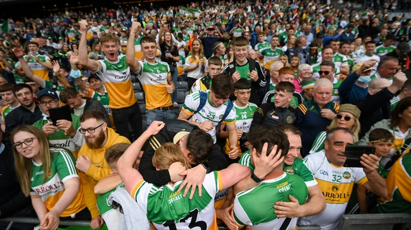 Offaly players celebrate with supporters after the final whistle