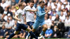 Jack Grealish is tracked by Spurs' Oliver Skipp