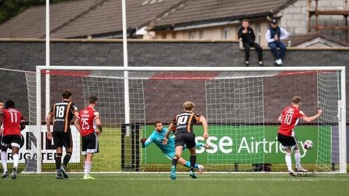 Jamie McGonigle slots home the winning penalty