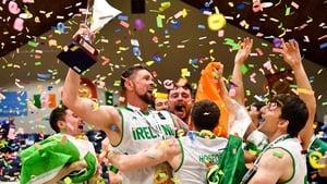 Ireland captain Jason Killeen raises the trophy in triumph