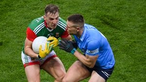 John Small collides with Eoghan McLaughlin