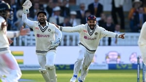 India celebrate the fall of the final English wicket at Lord's