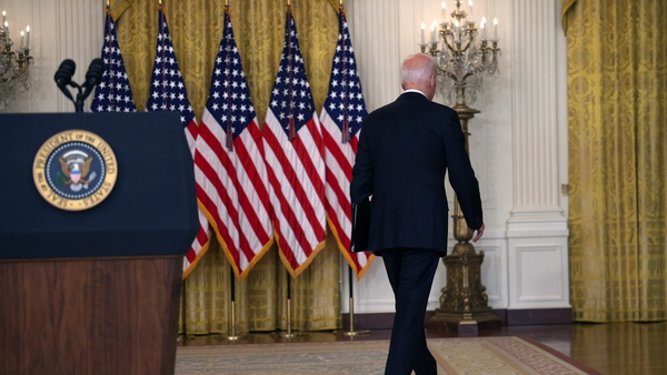 US president Joe Biden walks away from the East Room in the White House without taking questions after defending his decision to withdraw troops fromAfghanistan
