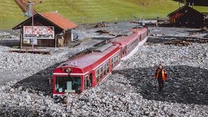 A train is stuck in the mud after flooding in Wald-im-Pinzgau near Salzburg